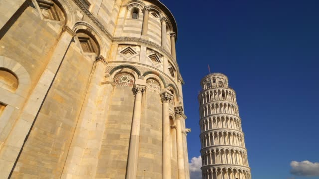 leaning tower of pisa and cathedral against blue sky in pisa, italy - pisa cathedral stock videos & royalty-free footage