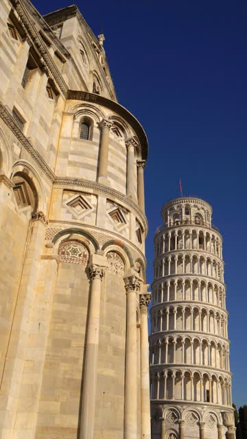 leaning tower of pisa and cathedral against blue sky in pisa, italy, vertical - pisa cathedral stock videos & royalty-free footage