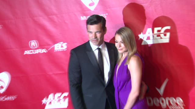 leann rimes and eddie cibrian at 2014 musicares person of the year honoring carole king at los angeles convention center on in los angeles california - musicares foundation stock videos & royalty-free footage