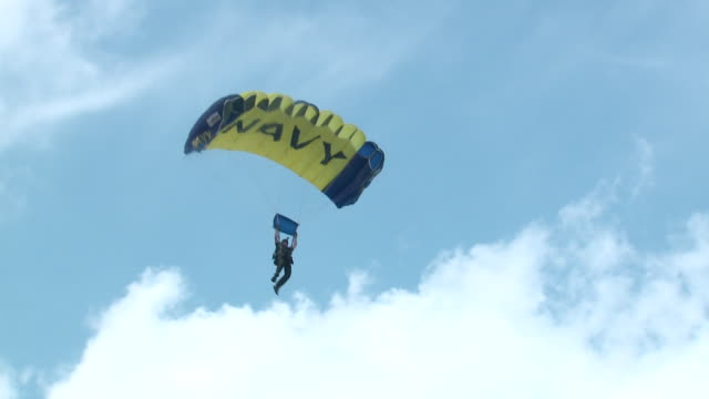 leap frogs u.s. navy parachute team member lakes on beach as part of the chicago air and water show on aug. 20, 2017. - chicago air and water show stock videos & royalty-free footage