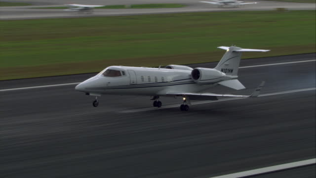 ws pan learjet landing before quickly taking off again/ florida - landing touching down stock videos & royalty-free footage