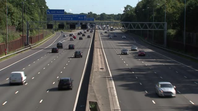learner drivers to be allowed on motorways / motorway traffic gvs; england: m25: ext gvs traffic on busy m25 motorway - good shots - m25 video stock e b–roll