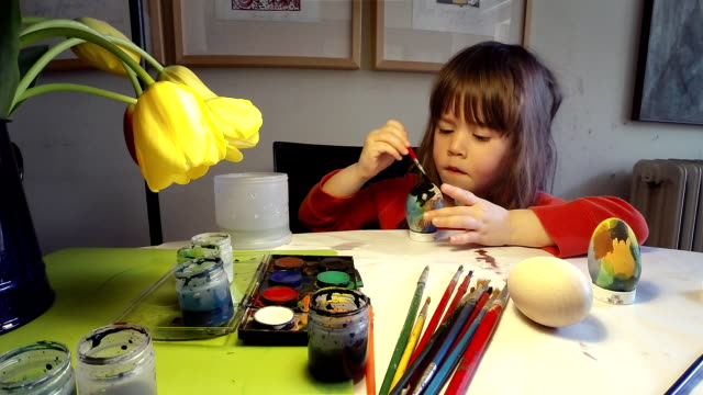 learning process-little girl painting easter eggs at home - ladder of success stock videos & royalty-free footage