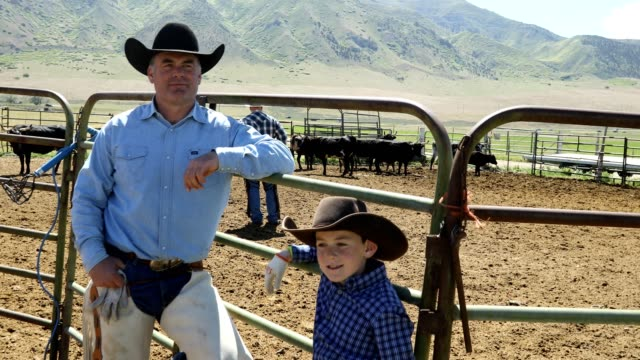 learning the ropes: father and son farm life on ranch - rancher stock videos & royalty-free footage