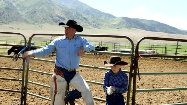 learning the ropes: father and son farm life on ranch - american culture stock videos & royalty-free footage