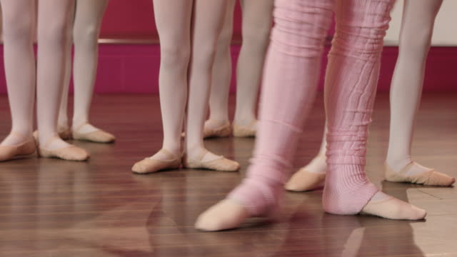 learning the steps - leg warmers stock videos & royalty-free footage