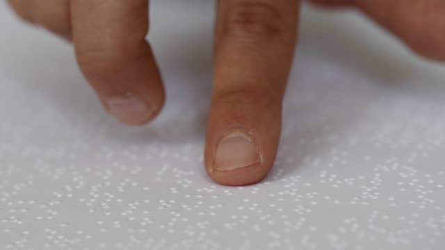 learning to read text in braille alphabet. extreme close-up of blind person hands reading. - braille stock videos & royalty-free footage