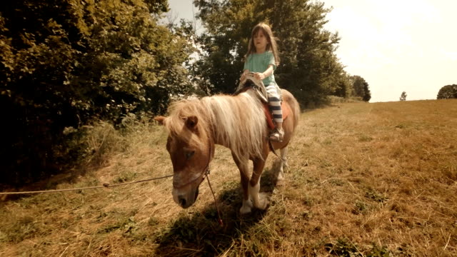 learning to ride a pony-child riding horse - horseback riding stock videos & royalty-free footage