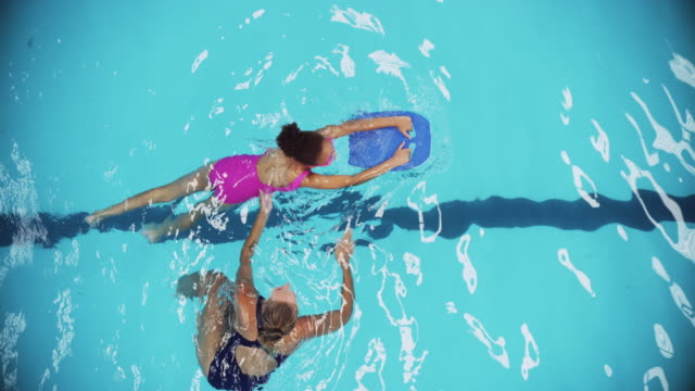 learning to swim from the best - swimming stock videos & royalty-free footage