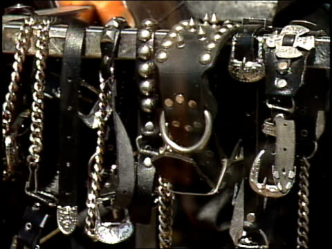 leather and spiked collars and bracelets in a store window - spiked stock videos & royalty-free footage