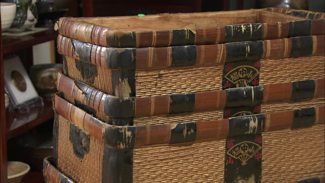 leather binding envelops a stack of wicker baskets inside a medicine shop in toyama japan - wicker stock videos & royalty-free footage