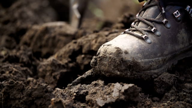 slow motion: leather boot - mud stock videos & royalty-free footage