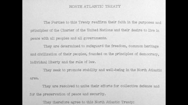 CU leather cover of bound treaty cover opens to reveal first two pages of treaty / closer view of first page of treaty / page turns to reveal second...