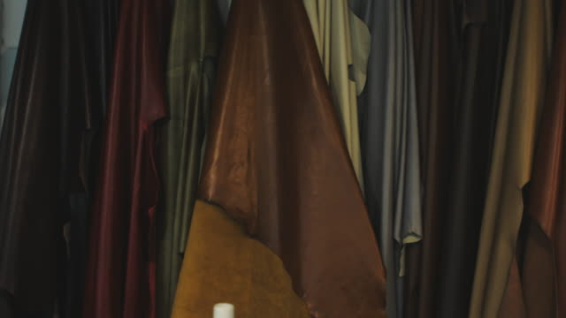 leather goods selection in store - leather stock videos and b-roll footage