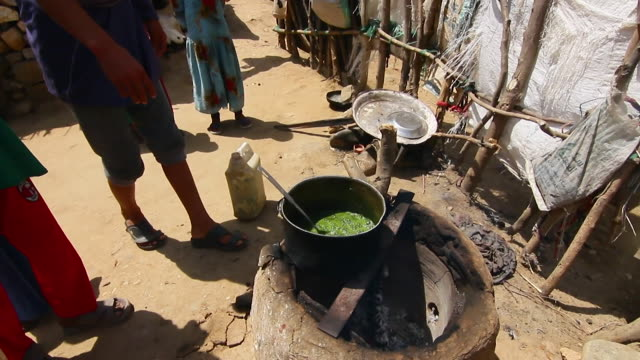leaves being cooked on a refugee camp in northern yemen - lid stock videos and b-roll footage