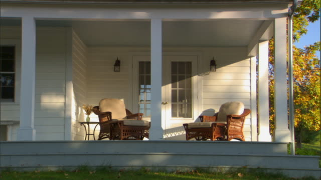 ms leaves on lawn/ tu large porch of house surrounded by trees/ livingston, new york - veranda stock videos & royalty-free footage