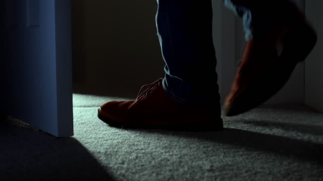 leaving a dark room, close up of man's feet. ds. - home interior stock videos & royalty-free footage