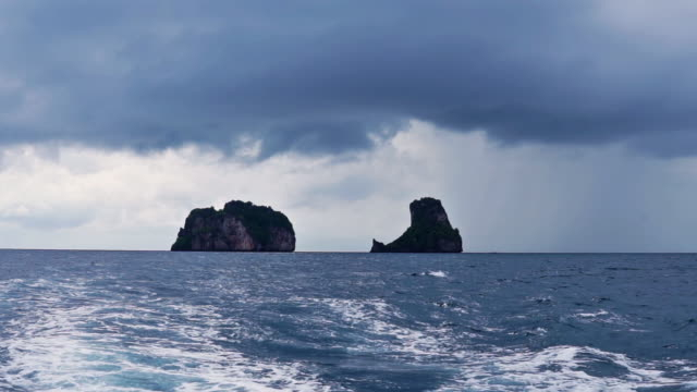 leaving bida nai and nok, phi phi by boat on stormy day - monsoon stock videos and b-roll footage