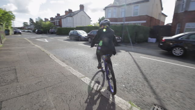 leaving for school - boy rides bicycle to school - uniform stock videos & royalty-free footage