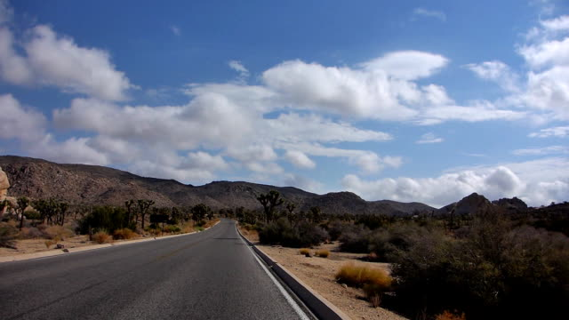leaving hall of horrors in joshua tree national park - joshua tree national park stock videos & royalty-free footage