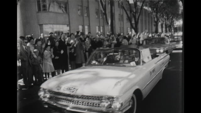 stockvideo's en b-roll-footage met leaving hotel leamington presidential candidate john f kennedy campaigns with hubert humphrey in minneapolis minnesota hubert humphrey - john f. kennedy