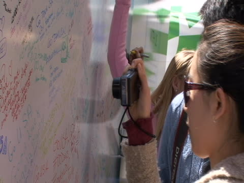 wall leaving messages for olympians at countdown to olympics event in times square in new york city - sport stock videos & royalty-free footage