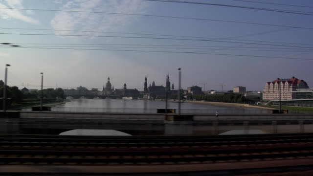 leaving railway station dresden-neustadt where an ice is waiting, driving over the river elbe with the view to the inner city / old city, city train... - river elbe stock videos & royalty-free footage