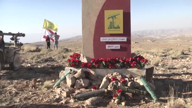lebanese and foreign media members attend a press tour guided by hezbollah hezbollah members in a mountainous area in the lebanese border town of... - hezbollah stock videos & royalty-free footage