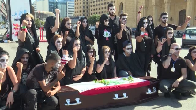 lebanese anti-government protesters take part in a symbolic funeral for the country in the downtown area of the capital beirut, on the third... - lebanon country stock videos & royalty-free footage