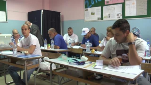 lebanese cast their ballots at a polling station during the lebanese local elections in tripoli, lebanon on may 29, 2016. - röstsedel bildbanksvideor och videomaterial från bakom kulisserna