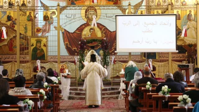 lebanese christians attend easter mass at the greek catholic melkite church of our lady of protection, in a suburb of beirut - christianity stock videos & royalty-free footage