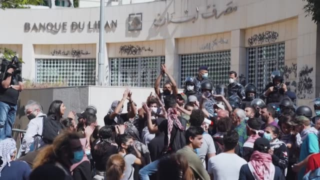 lebanese demonstrators close streets march and chant slogans across the capital beirut to mark international workers' day as a spiralling economic... - crisis stock videos & royalty-free footage