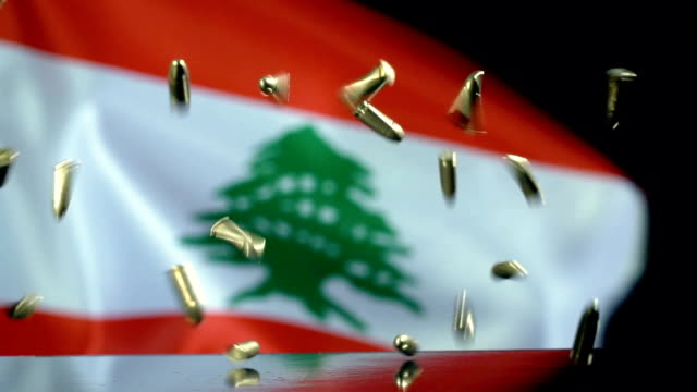 lebanese flag behind bullets falling in slow motion - lebanese flag stock videos and b-roll footage