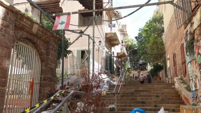 lebanese flag flies on the gemayze stairs shown covered in rubbish bags following the beirut port explosion of august 4th 2020. the explosion at... - last stock videos & royalty-free footage