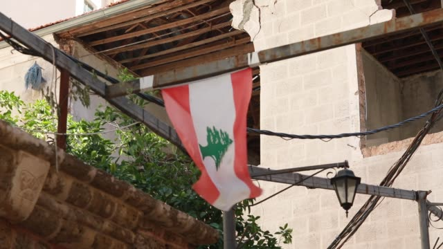 lebanese flag hangs in the damaged street following beirut port explosion of august 4th 2020. the explosion at beirut's port last week killed over... - last stock videos & royalty-free footage
