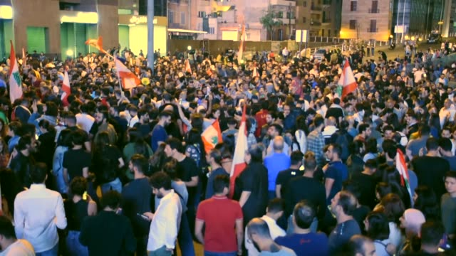 lebanese people take part in an anti-government protest in reaction to president michel aoun's speech in beirut, lebanon on november 12, 2019.... - lebanon country stock videos & royalty-free footage