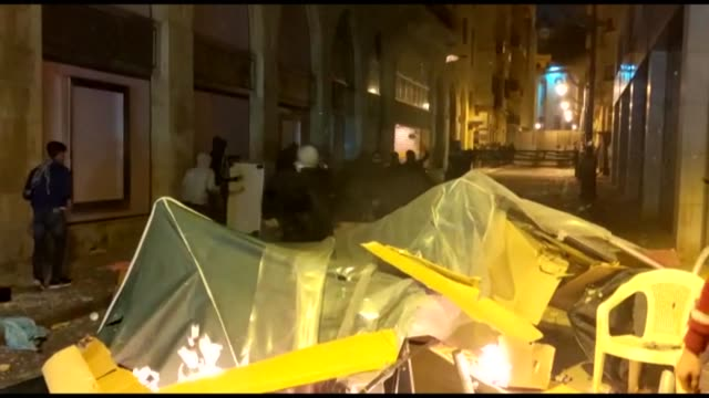 lebanese protesters break and burn a tent in downtown beirut angry with the new government line-up, arguing it fell short of a clean break from the... - politics and government stock videos & royalty-free footage