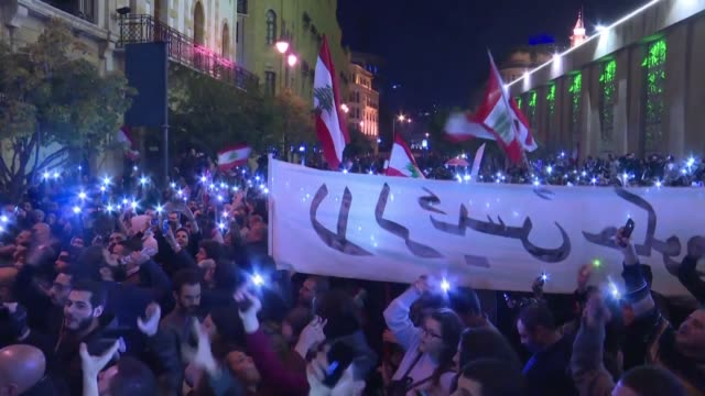 lebanese protesters chant anti government slogans and wave flags near the parliament in downtown beirut keeping up demands for a complete overhaul of... - lebanon country stock videos & royalty-free footage