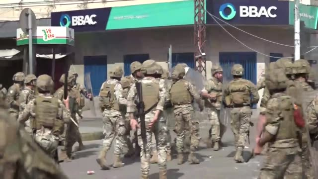 lebanese protesters clash with soldiers in the northern port city of tripoli on april 28 as anger over a spiralling economic crisis re-energised a... - lebanon country stock videos & royalty-free footage