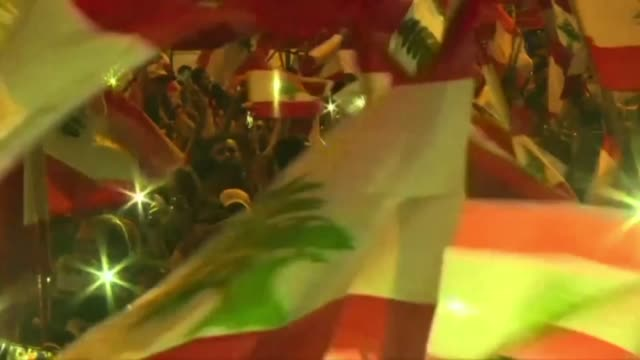 lebanese protesters gather in mass in beirut's martyrs' square at dusk chanting revolution and waving national flags on the tenth consecutive day of... - revolution stock videos & royalty-free footage