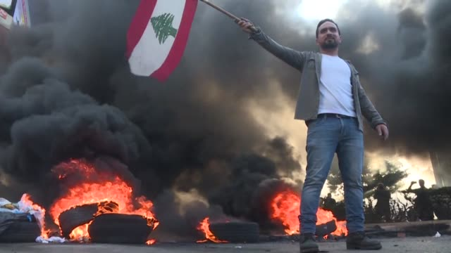 vídeos de stock, filmes e b-roll de lebanese protesters resume blocking a major road in the capital beirut in what they said would be a week of wrath demanding an end to a months long... - major road