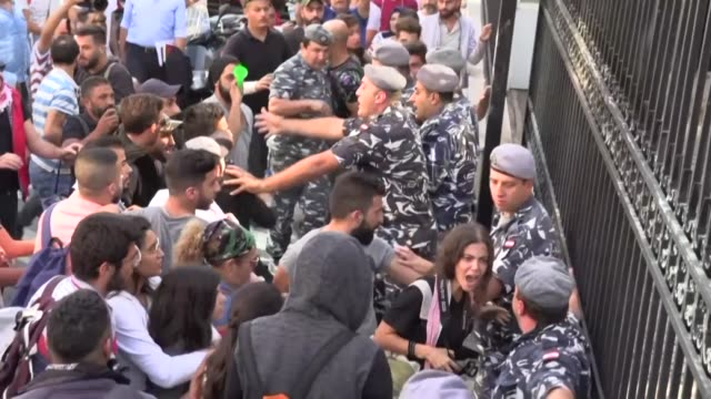 lebanese protesters scuffle with security forces as they try to break into the beirut bar association after a lawyer was accused of assaulting a... - judge stock videos & royalty-free footage