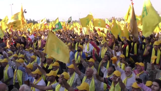 lebanese shiite movement hezbollah on thursday held a rally in baalbek to mark its second victory after its fighters battled islamic state jihadists... - hezbollah stock videos & royalty-free footage