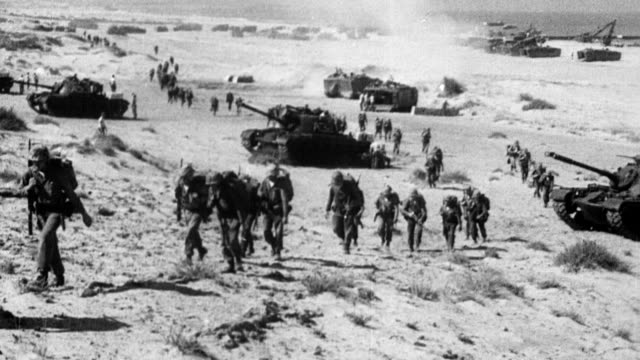 lebanon coastline / us troops and tanks land on beach / landing crafts with soldiers arrive on the beach / soldiers marching along beach / lebanese... - lebanese ethnicity stock videos and b-roll footage