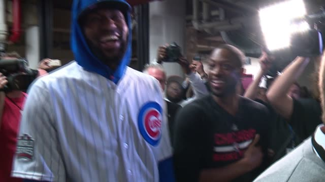 534137d64 WGN- LeBron James wears a Cubs uniform as he walks from the team bus...  Stock Footage Video