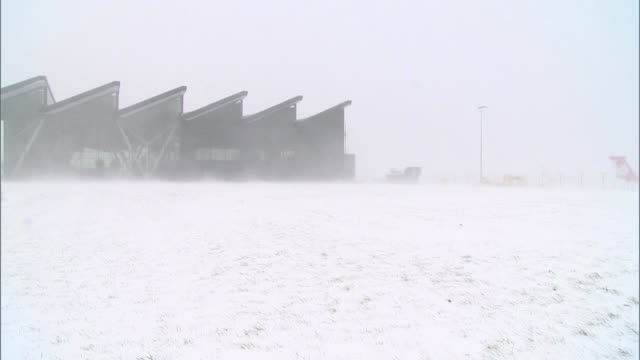 lech walesa airport during snow storm - airport stock videos & royalty-free footage