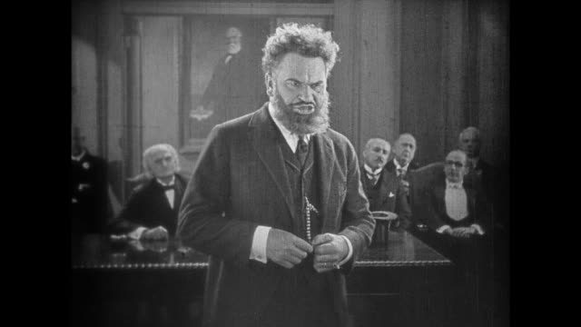 1925 lecture hall audience applaud as man questions eccentric speaker - 1925 stock videos & royalty-free footage