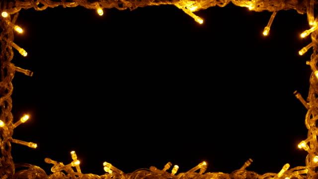 led licht schwarz rahmenhintergrund - fairy lights stock-videos und b-roll-filmmaterial