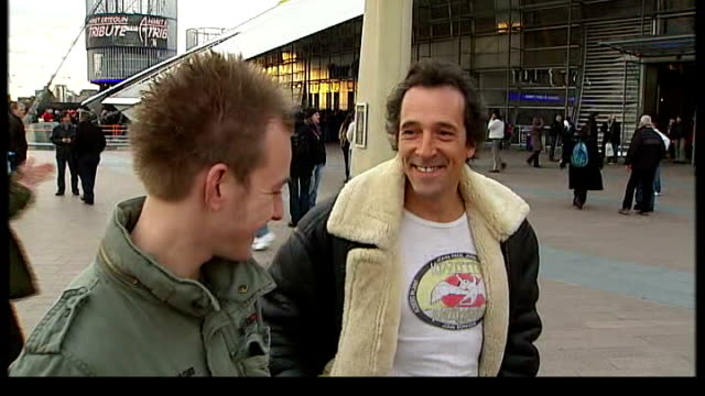 led zeppelin reunion concert; england: london: o2 arena: ext david luft interview standing next other fans sot - the o2 england stock videos & royalty-free footage