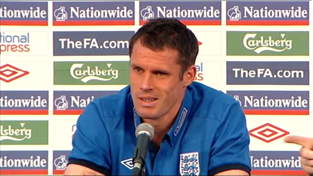 Ledley King injury INT Jamie Carragher at press conference Jamie Carragher press conference SOT ENGLAND London EXT Rio Ferdinand down steps then...